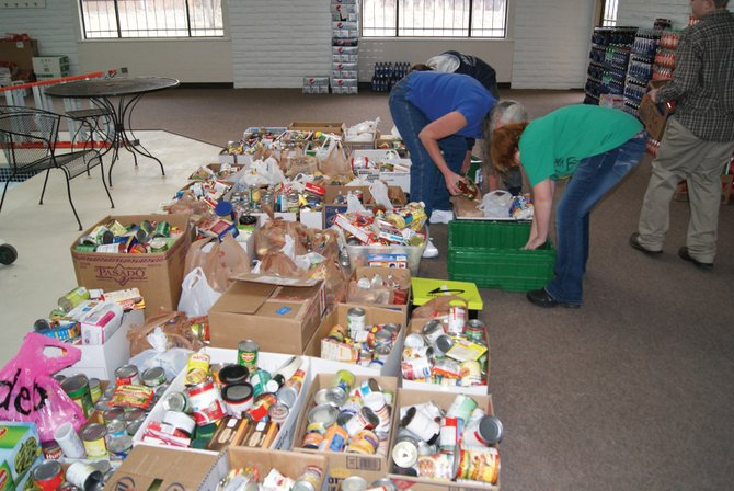 Cans of food line the inside of the Inter Faith Food Bank. Collected by Craig Middle School, seventh graders in Drew Morris's focus group, who collected the most cans, delivered the canned goods to the food bank Thursday morning.