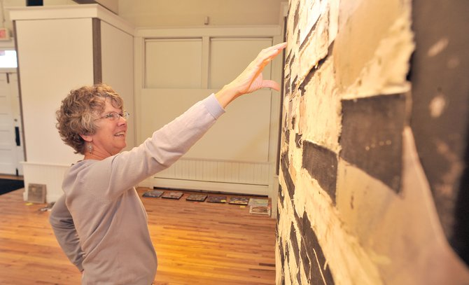 "Local artist Cindy Wither talks about how a piece, shown in the background, by local artist Gregory Block inspired her own work for the Steamboat Springs Arts Council's ""Reconstruction"" show."