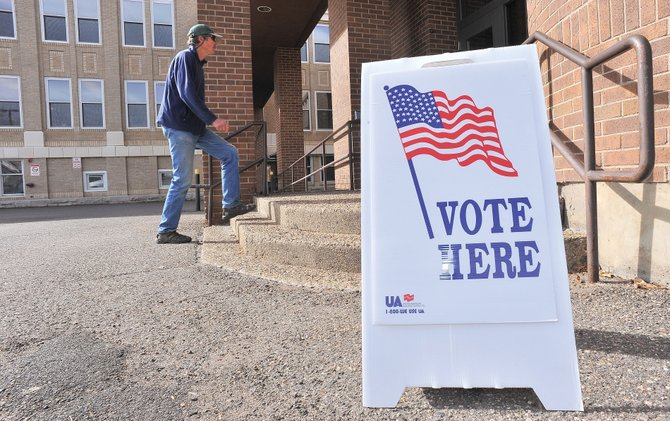 Routt County resident Chan Spear heads into the Routt County Courthouse annex Thursday to cast his vote in the 2012 election.