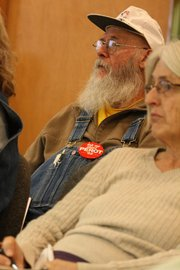 Craig resident Bob Grubb listens to a response from Sue Birch, Executive Director of Health Care Policy and Financing for the State of Colorado, to his question about rumors of death panels under health care reform in a presentation Friday at the Craig City Council Chambers.
