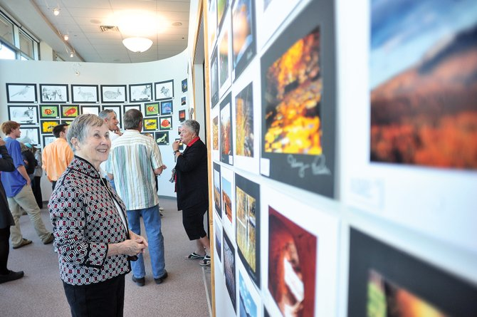 Shirlee Finney looks at the art in the new gallery named after her late husband, Jack Finney, at Steamboat Springs High School. The gallery officially opened Friday evening with a ribbon-cutting ceremony and the start of a new student art show.