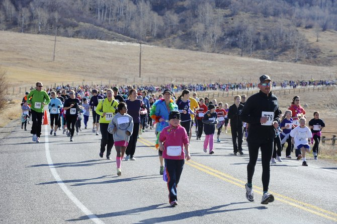 Runners come down Amethyst Drive during the Girls on the Run 5-kilometer running event Saturday. The run started at Steamboat Springs Middle School.