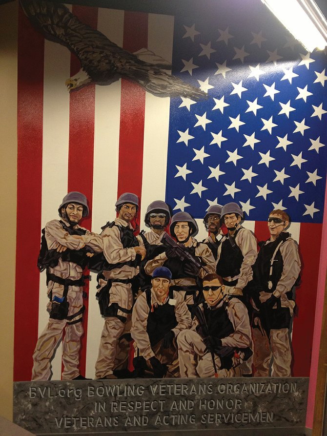 This painting on the wall at Thunder Rolls Bowling Center depicts a group of marines posing for a picture. It was painted by Nini Shroyer at the bowling alley for the upcoming Bowl for Veterans event slated for noon to 4 p.m. Sunday. The proceeds of the day will benefit Bowlers to Veterans Link, which provides military veterans with access to sports, recreation and the arts.