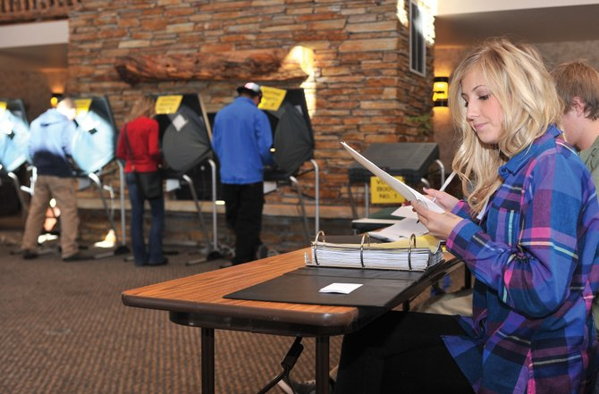 Election judge Maddy Globe waits to register another voter at the Mountain Resorts building polling place in Steamboat Springs midday Tuesday. Officials there said they've seen a steady flow of voters through the first part of the day, but no significant lines have been reported at any Routt County precinct location.