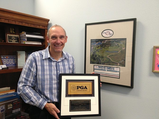 Chuck Cobb, 55, poses with his plaque from last Friday's Colorado Professional Golf Association awards banquet. Cobb was given the Warren Smith Award, for achievements as a golf professional throughout an entire career. Cobb has been a PGA member for 26 years.