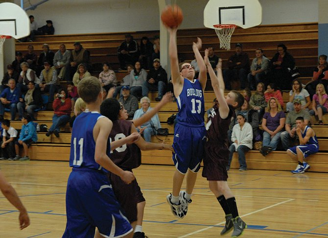 Dominic Pascetti goes up for a shot after grabbing an offensive rebound Friday at Craig Middle School. The Bulldogs seventh- and eighth-grade boys teams beat Soroco, 34-7 and 41-9, respectively.