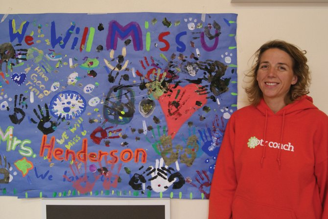 Craig Middle School counselor, Michelle Henderson, stands in front of one of the many going away signs made by her students. After three and a half years at CMS, Friday was Henderson's last day.
