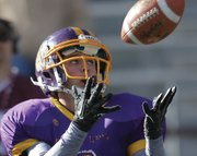 Conner Lee, a Little Snake River Valley senior, looks to haul in pass during the Wyoming 6-man state championship game Friday at War Memorial Stadium in Laramie, Wyo.