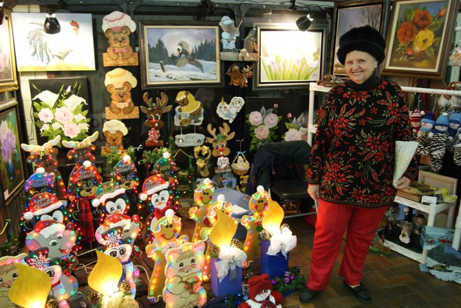 Betty Watson of Grand Junction, stands at her booth during the Holiday Craft Show at the Centennial Mall in Craig Saturday. The event ran from 9 a.m. - 4 p.m. and had something for almost everyone.