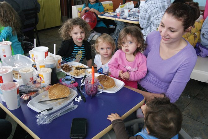 Kids enjoy their pancakes during breaks from playing in McDonald's Playland Saturday morning at the SAPP pancake breakfast. The Craig McDonald's hosted the breakfast for the second week in a row, packing the restaurant with kids and parents.