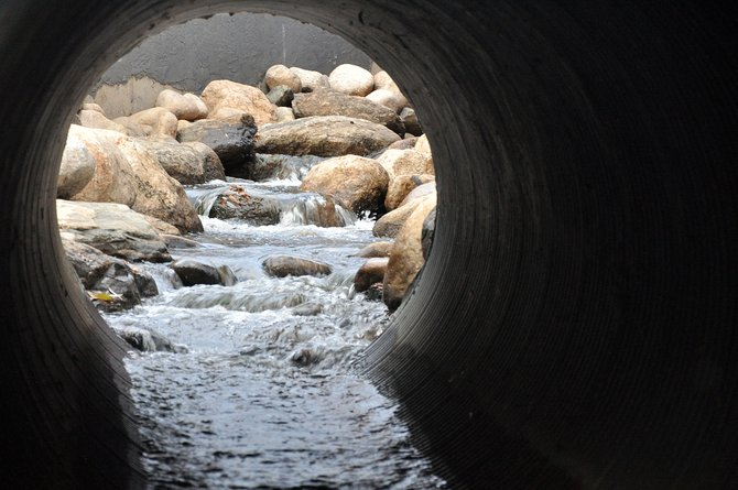 Water runs down a culvert Friday near the intersection of Lincoln Avenue and Seventh Street. Depending on the results of an ongoing study of the city's stormwater system, Steamboat residents as soon as next year could start to pay a new fee to fund upgrades to the system.