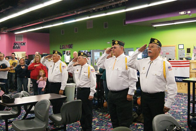 Craig American Legion members (from right) Jake Garcia, Bill White, Michael Lausin and Al Shepherd lead Thunder Rolls bowling alley in the Pledge of Allegiance Sunday at Thunder Rolls Bowling Center. Thunder Rolls hosted a Bowling for Veterans event to raise money for
