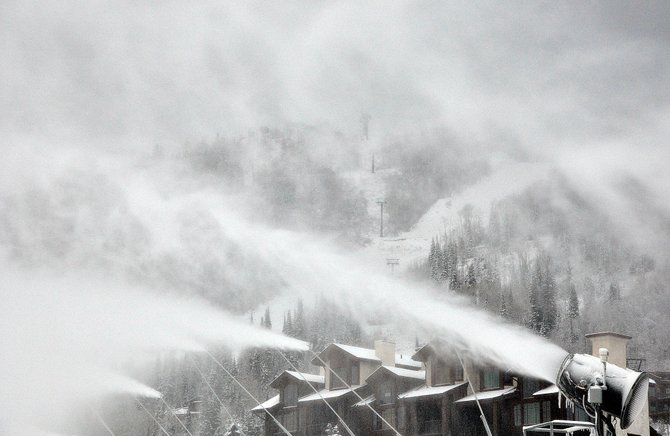 Snow guns fire at the base of Steamboat Ski Area on Sunday morning as a winter storm moves through the area. The recent snowstorm and colder temperatures have allowed the ski area to resume snowmaking after a warm, dry week.