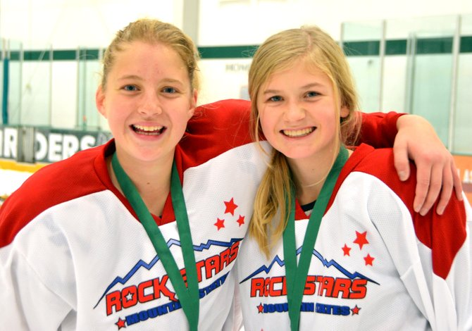 Cassett Yeager, left, and Libby Lukens, were a part of a winning U14 hockey team over the weekend. The squad's success earned it a trip to play at another tournament in February in Canada.