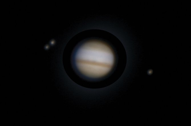 The giant planet Jupiter is entering our evening sky and will dazzle us all winter and spring. Through a telescope, you can watch Jupiter's four planet-sized moons shift their positions from night to night. In this image, taken through the historic 60-inch Hale Telescope at Mt. Wilson Observatory on Nov. 13, 2010, Jupiter is seen with three of its moons: from left, Europa, Ganymede and Io.