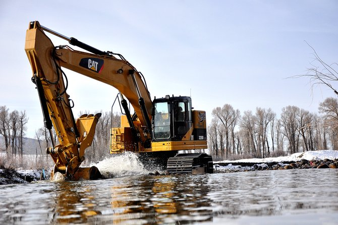 Crews with Nordic Excavating work Wednesday to restore a stretch of the Yampa River west of Steamboat Springs. The project aims to improve instream aquatic habitat and recreation in the river and stabilize highly eroded river banks.