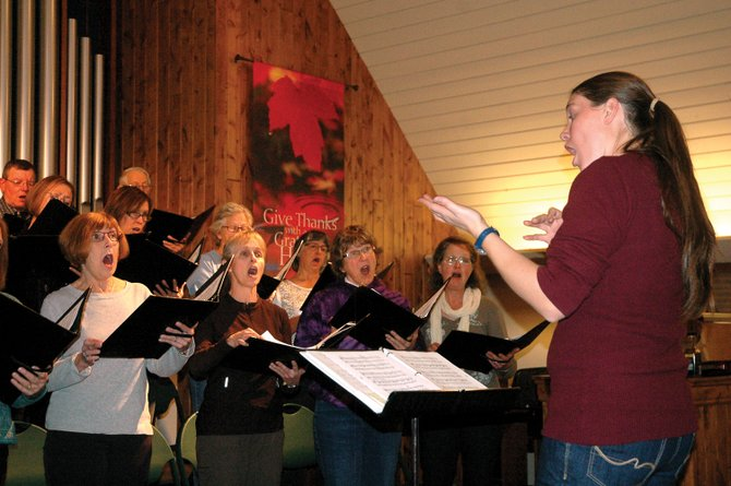 "Yampa Valley Singers director Anna Jones leads the local choir in a rehearsal Wednesday at the United Methodist Church of Steamboat Springs. The choir will present its concert, ""What a Wonderful World,"" at 7 p.m. Friday and 4 p.m. Saturday."
