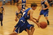A Craig Middle School eighth-grader drives past his defender from Snake River during the eighth-grade game Thursday night at CMS. The Bulldogs pulled away early and won over a tough Rattlers team, 28-22.