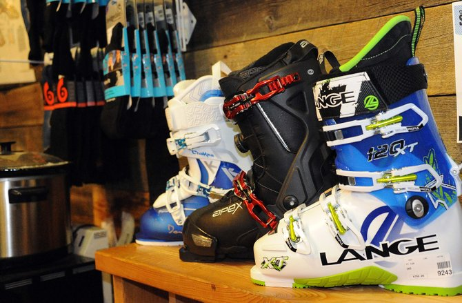 The newest gear for the imminent ski season is up and ready to go in local shops. Much of the innovation in the snowsports industry has come in AT, or Alpine touring, gear, including boots. While Dalbello, left, and Apex, center, have found ways to make their boots more comfortable and less expensive, Lange, right, built in a switch to assist hikers and allow them to transition between the climb up a mountain and the ski back down.