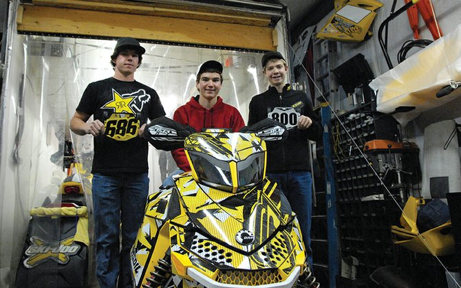 From left: Wesley Chapman, 18, Austin Gabbert, 18, and A.J. Stoffle, 14, stand with Gabbert's Snocross sled. The Craig residents and Snocross competitors started driving today for the International Series of Champions season kickoff in Duluth, Minn. They will race Nov. 23-25, and race throughout the winter around Colorado and Wyoming.
