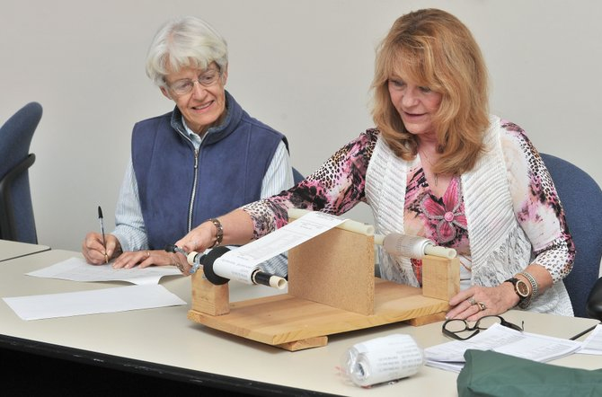 Routt County Clerk and Recorder Kay Weinland, right, and election judge Lynn Abbott verify results from this year's election at the Routt County Courthouse in downtown Steamboat Springs. Abbott, Weinland and election judge Brita Horn audited this year's results.