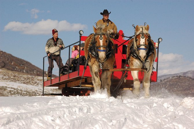 Jared Iacovetto drives a team of Belgian draft horses on a sleigh ride at Saddleback Ranch in 2006. On Wednesday, Steamboat Ski Area announced its plans to host horse-drawn sleigh rides at the city-owned Haymaker Golf Course this winter. Saddlebacks Wayne Iacovetto said he is concerned the ski areas new sleigh ride will take away from his revenue.