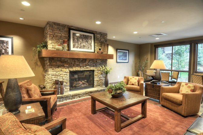 The lobby of Trailhead Lodge has a reception desk and gathering area for guests. The remaining 30 unsold condominiums, most of them one- and two-bedrooms, go to auction for the second time Dec. 15.