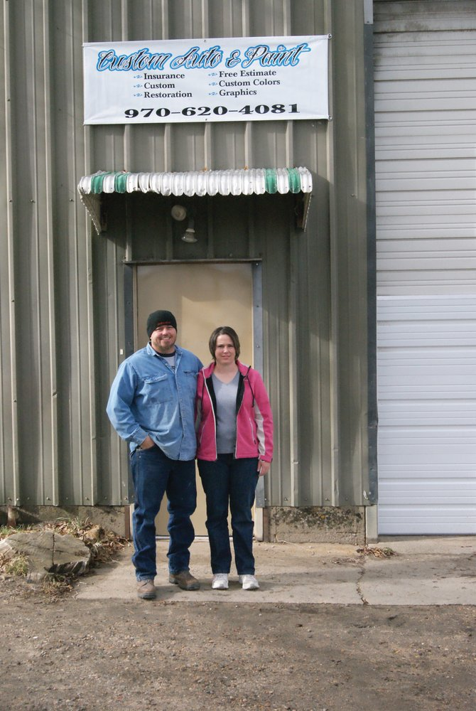 James Hand and his wife, Brenda, stand in front of their new shop, Custom Auto and Paint, 324 School St. in Craig.