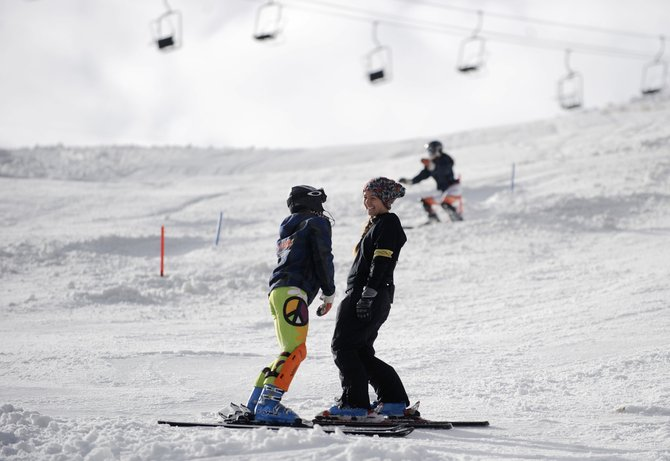 2008 Steamboat Springs High School graduate Jenny Allen, right, visits with Sawyer Gander, 13, during training Saturday morning at Howelsen Hill. Allen has returned to the club to help coach the U16 Alpine team.