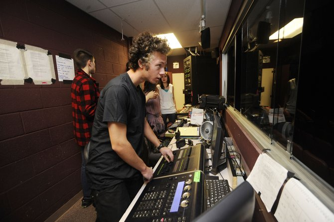 "Lighting director Danny Kramer makes adjustments before the Saturday matinee of ""Urinetown"" at Steamboat Springs High School."