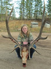 Kendra Halder poses with the antlers from the bull she killed in GMU 15 during the second elk hunting season this year. Halder has been hunting for two years.