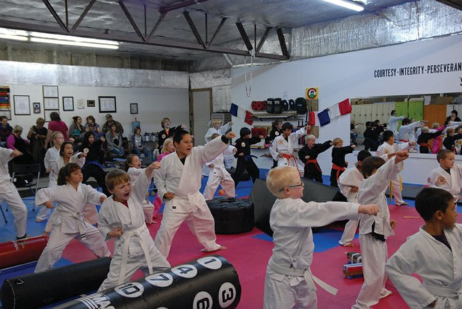 Children in the Taekwondo class at Northwest Colorado Taekwondo practice their punches while warming up before a class Monday afternoon. Paul Cruz started the karate classes three years ago in Craig, and hosts students ages 3-54 six days a week.