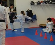Children went through an obstacle course testing their agility and taekwondo techniques at Northwest Colorado Taekwondo class Monday afternoon at 420 Breeze St. Here, a white belt works her way through the kicking station of the course.