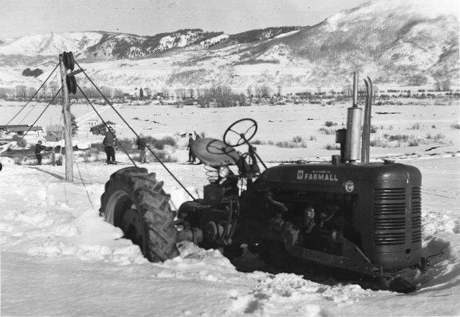 A tractor drives the rope tow in the 1950s. The tow was installed on a hillside pasture on the Fetcher ranch in Clark.