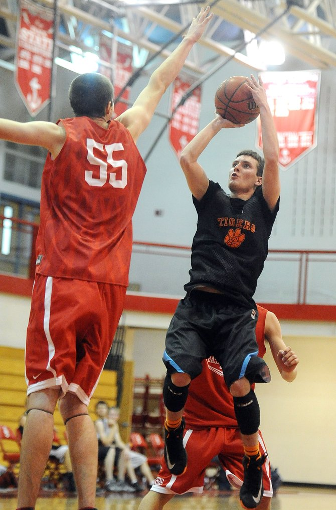 Hayden senior Paul Laliberte pulls up for a shot in the lane Saturday during a scrimmage against Steamboat Springs. Laliberte is one of the Tigers&#39; top returning players after he averaged 20 points per game last season. 