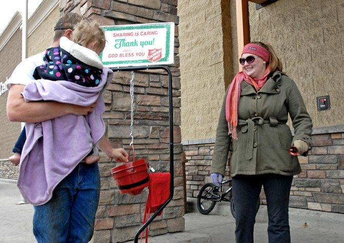 Jana Thompson, a parishioner at The Journey at First Baptist Church, volunteered Sunday for the Salvation Army Red Kettle Campaign outside of Walmart in Craig. About 90 percent of the funds raised from the Red Kettle Campaign benefit needy individuals and families in Moffat County.