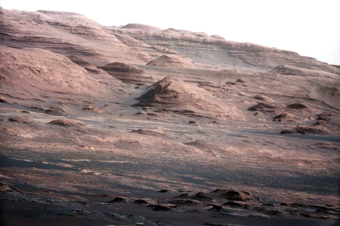 "What ""history book"" discovery has Curiosity made in the red sands of Mars? NASA will tell us in a week or so. This is how the robotic eyes of NASA's Curiosity rover see its destination — the sedimentary clay layers on the flanks of Mt. Sharp inside of the Gale crater."