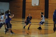 Jazmine Swindler (center) drives toward the basket during girls basketball practice at the Moffat County High School gym. Swindler is one of several juniors who will add depth to a talented and senior-heavy girls roster.