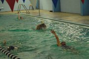 Eryn Leonard (center) swims breaststroke during girls swim team practice at the Moffat County High School pool. Leonard has made the state meet in each of her three years with the Bulldogs and will look to repeat that in her senior year.