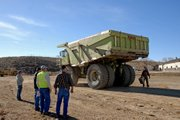 A Euclid 302LD Dump Truck is unloaded Tuesday near its new home on the south side of the Wyman Museum. The truck, recently retired and donated to the museum by Trapper Mine, hauled more than 1,344,000 tons of coal and ash during its 20 years of service at Trapper Mine.