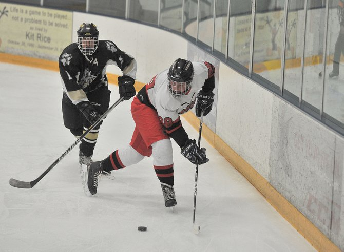Steamboat Springs High School's Michael Samuelson feeds the puck to the front of the net in the first period of Wednesday night's hockey game against Battle Mountain.