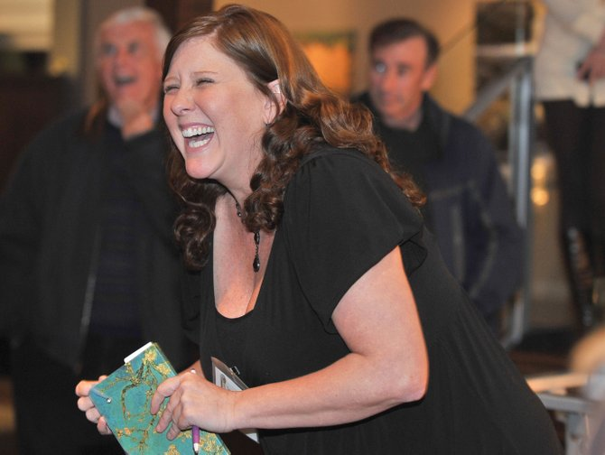 Tamara Beland laughs while joking with supporters of the Chief Plaza Theater on Wednesday evening at Sweetwater Grill. Beland was introduced at the new executive director of the downtown performing arts center.