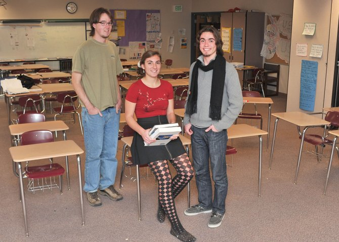 Steamboat Springs High School seniors Zach Schmidt, left, and Garrison Osteen, right, are semifinalists for the National Merit Scholarship. Jessie Wallace, center, is a semifinalist for the Boettcher Scholarship. The students will learn in February whether they will receive the awards.