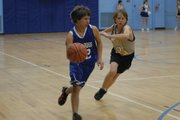 Lane Gonzales, an eighth-grader at Craig Middle School, beats his defender on a drive to the basket Tuesday evening at CMS. The B team lost the game, 40-27.