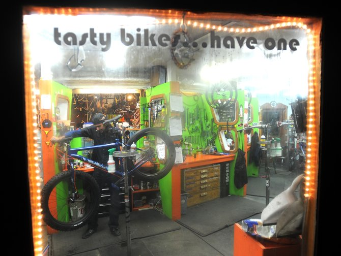 Essam Welch tunes up a bike on a dark afternoon at Orange Peel Bicycle Service in Steamboat Springs. Orange Peel reported a busy month and its longest season of cycling in its history. Things got under way early in March when the snow stopped last spring. And they&#39;re still rolling as skiers and snowboarders wait for the skies to open up.