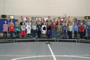 Ridgeview Elementary School first graders perform Thursday afternoon in the school gym during their school concert.