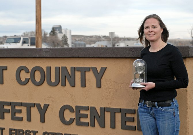 Det. Jen Kenney poses with a clock she received for being named the 2012 Craig Daily Press Citizen of the Year. Kenney was nominated for her numerous contributions to Craig and Moffat County, in addition to being uniquely adept at investigating some of Craig's most difficult cases.