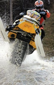 Wesley Chapman rides his snowmobile at the International Series of Champions Duluth National Snocross event last week. Chapman, 18, and friends Austin Gabbert and A.J. Stoffle attended the international race in Duluth, Minn. to kick off the Snocross season.