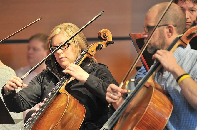 Performer Elissa Green plays her cello during a rehearsal Friday morning at Strings Music Pavilion. The Steamboat Symphony Orchestra will perform at 7 p.m. Saturday and 5 p.m. Sunday.