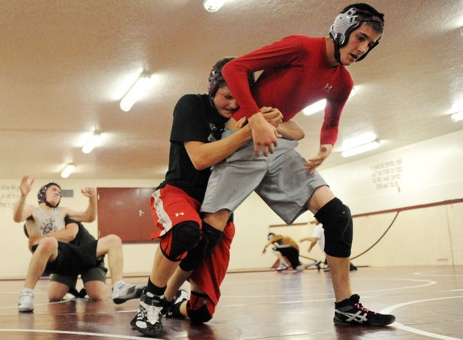 Soroco's Colten Martindale, right, and Garrett McCuller wrestle Friday. The Rams join Hayden and Steamboat Springs on Saturday in kicking off their seasons with a tournament at Middle Park.